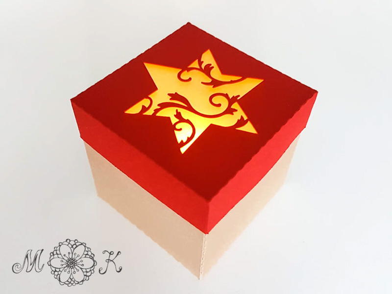 Schoki-Verpackung mit Stern - beleuchtet mit LED-Teelicht